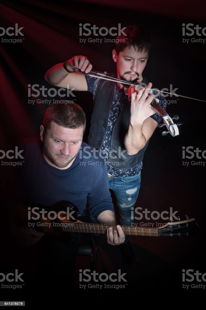 Band guitarist and violinist stock photo