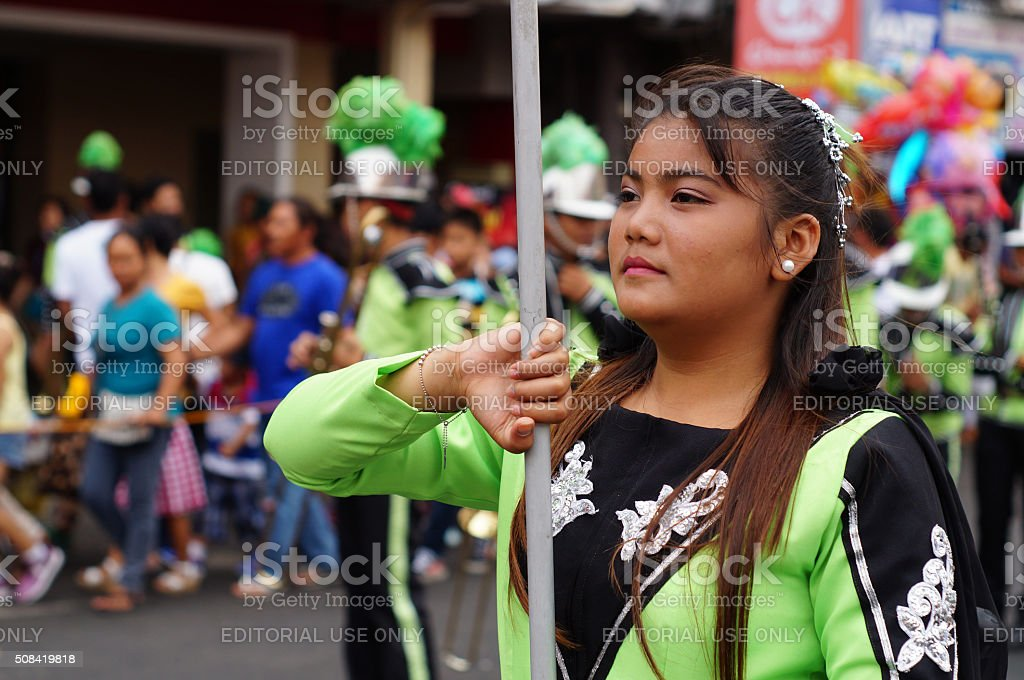 Band majorette perform flag waving skills stock photo