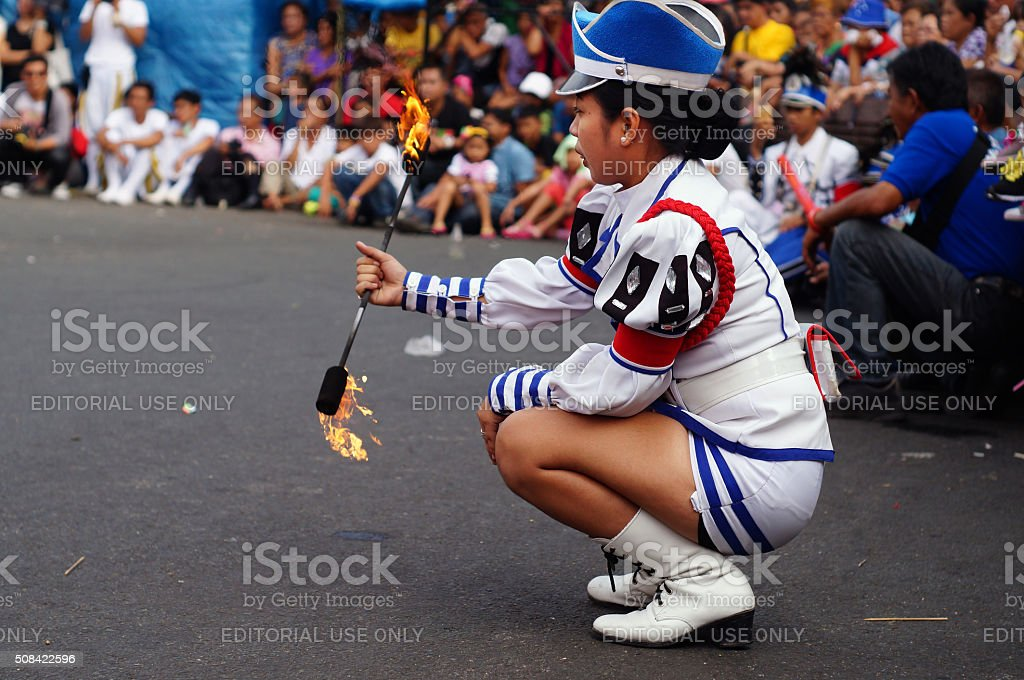 Band majorette plays fire stock photo