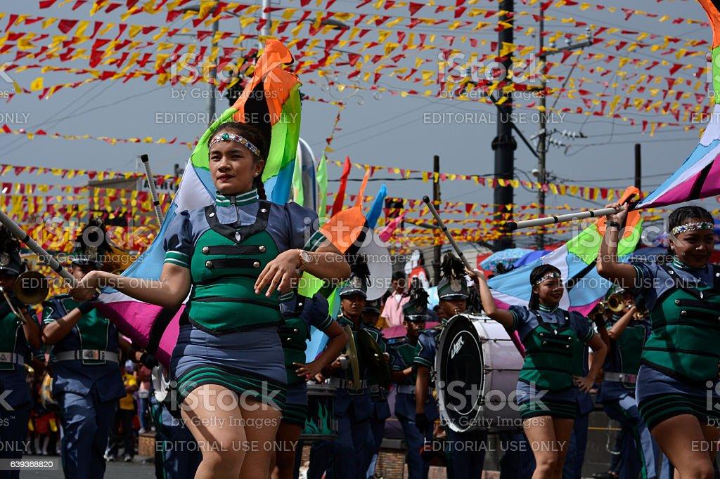 Band majorettes perform flag waving dancing skills - fotografia de stock
