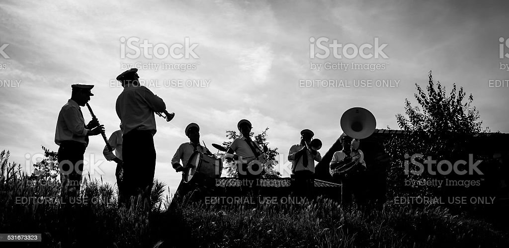 Band musicians backlight. BW image stock photo