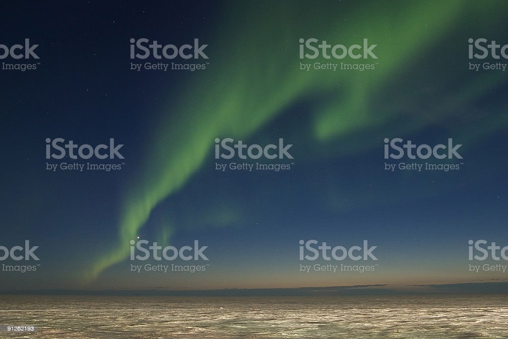 Band of nortern lights over arctic tundra royalty-free stock photo