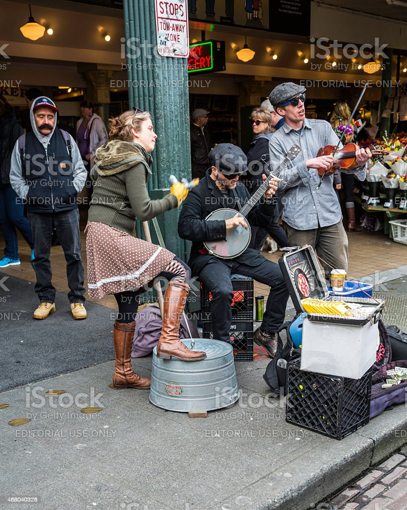 Band of street musicians perform in Seattle, Washington. stock photo