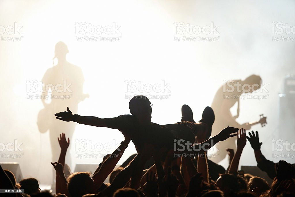 Band on Stage with Crowd Surfing royalty-free stock photo