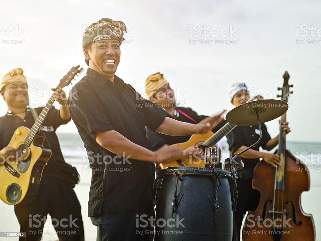 Band performing on the beach stock photo