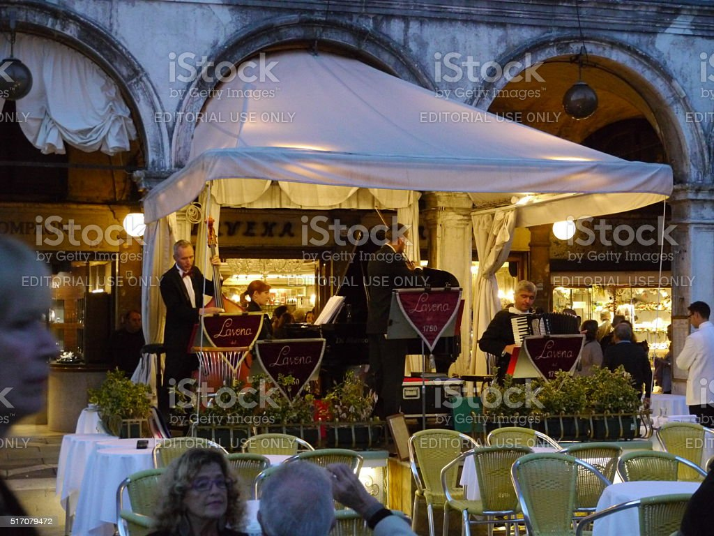band playing music for tourists at old venetian Cafe stock photo