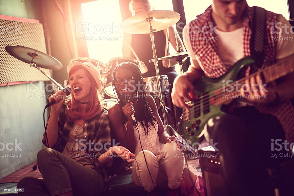 Band rehearsing in a studio stock photo