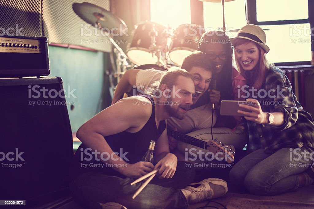 Band relaxing after rehearsal stock photo
