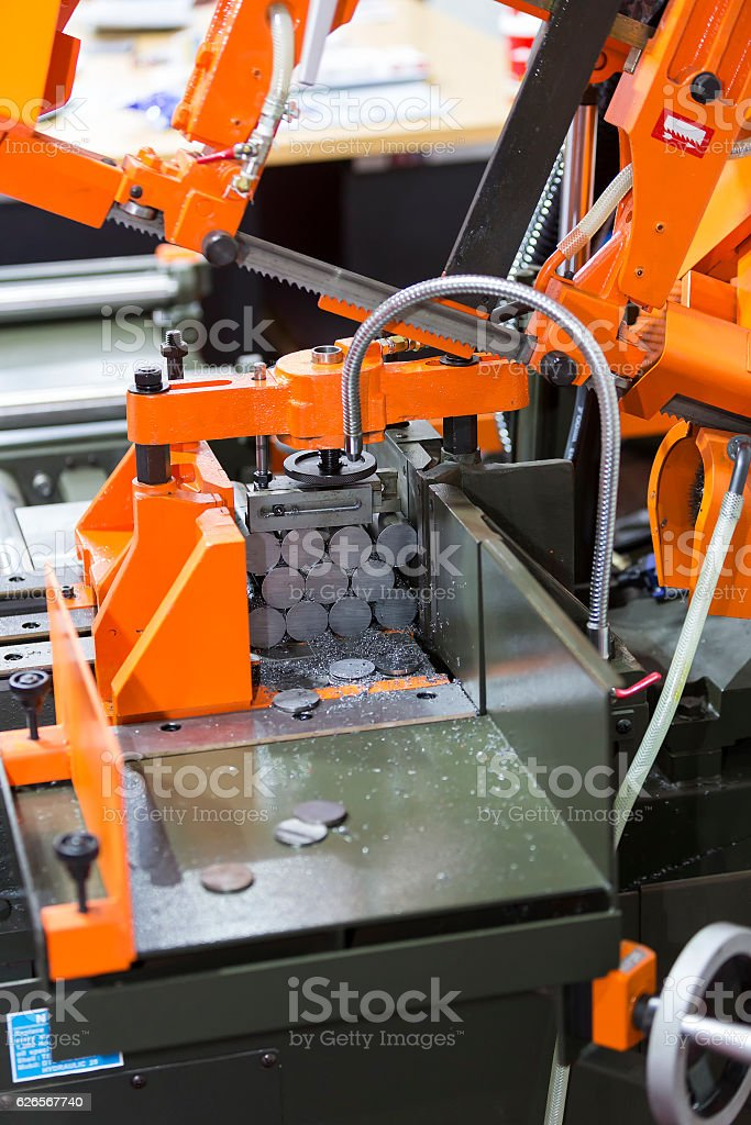 band saw cutting steel bar stock photo