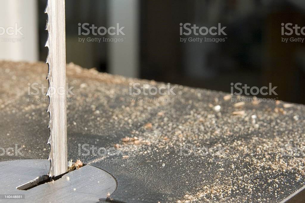 Band saw with sawdust stock photo