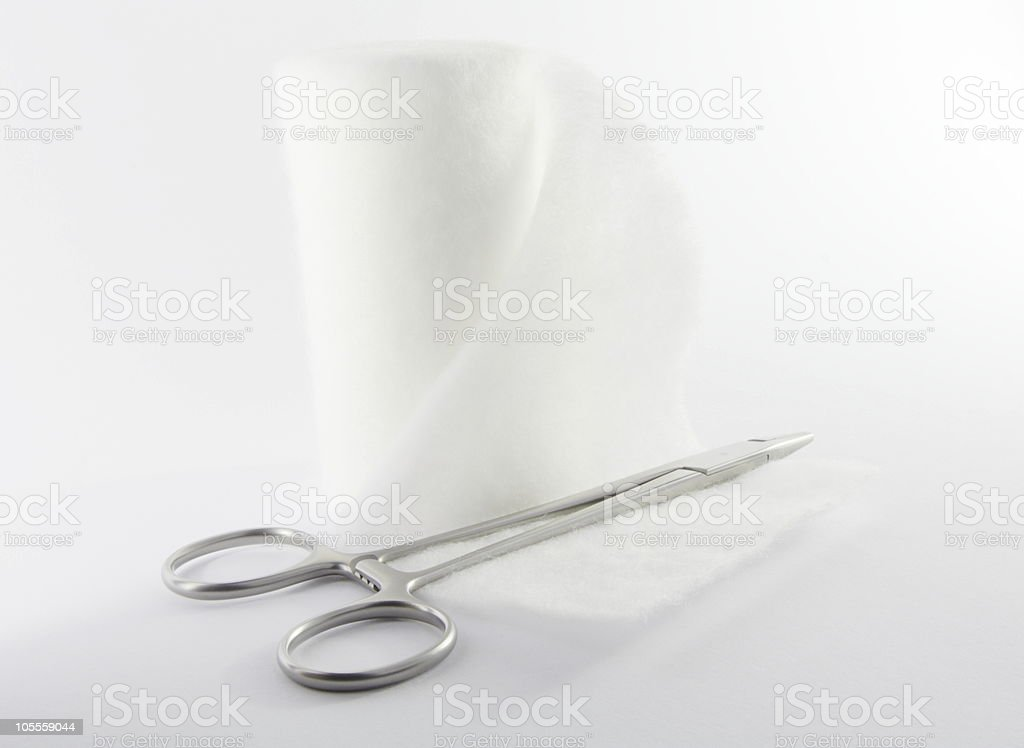 Bandage and surgical clamp royalty-free stock photo