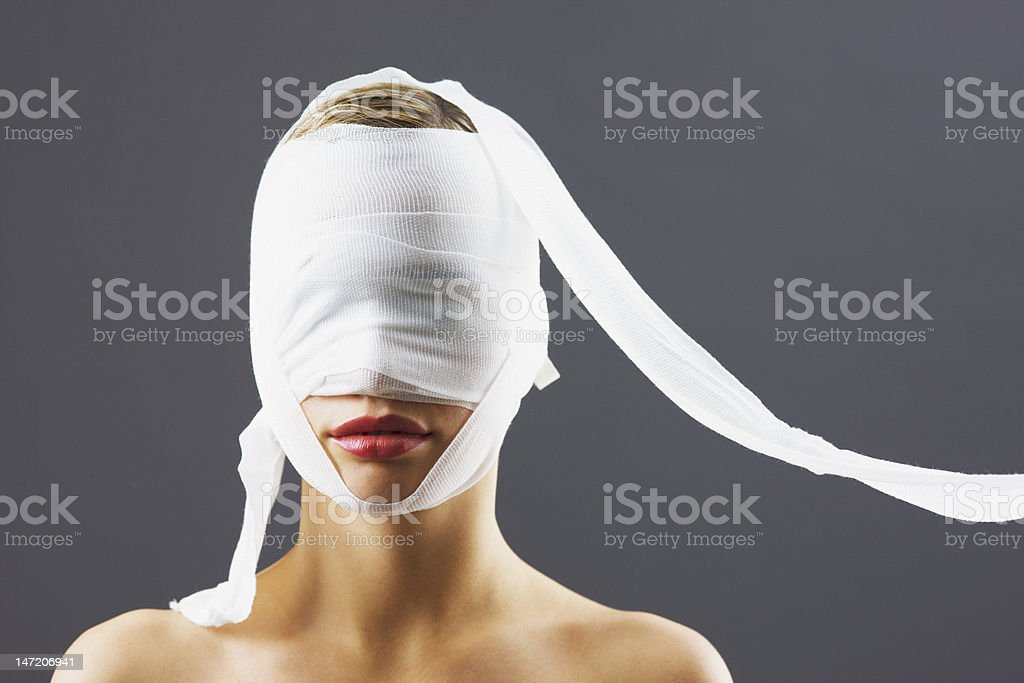 Bandage covering woman's face stock photo