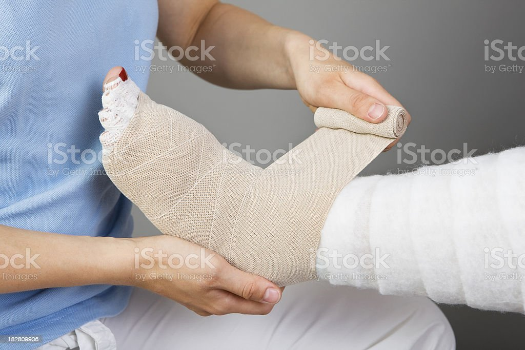 Close up of the hands of a young physiotherapist applying a...