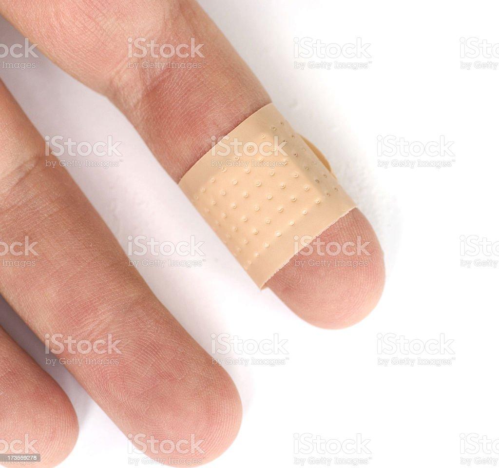 bandage on finger stock photo