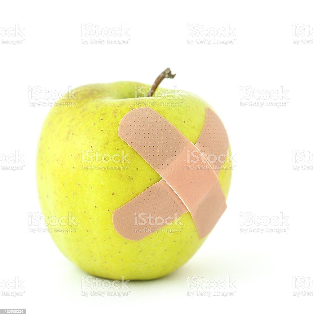 Bandaged Apple royalty-free stock photo