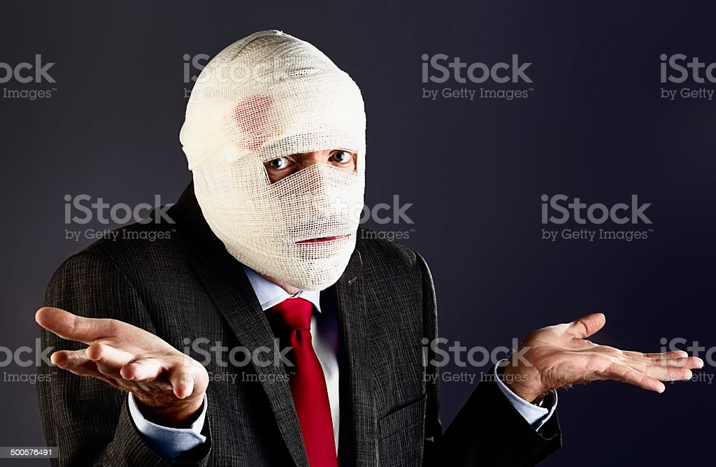 Bandaged businessman man shrugs stock photo