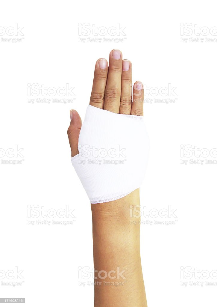 Bandaged hand isolated on white, with clipping path royalty-free stock photo