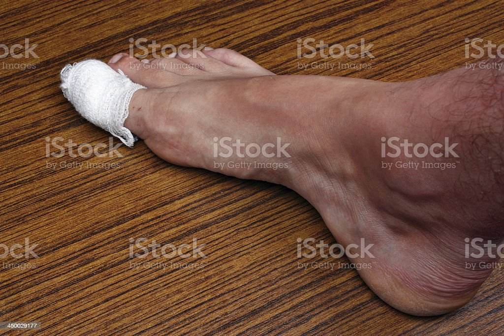 Bandaged toe royalty-free stock photo