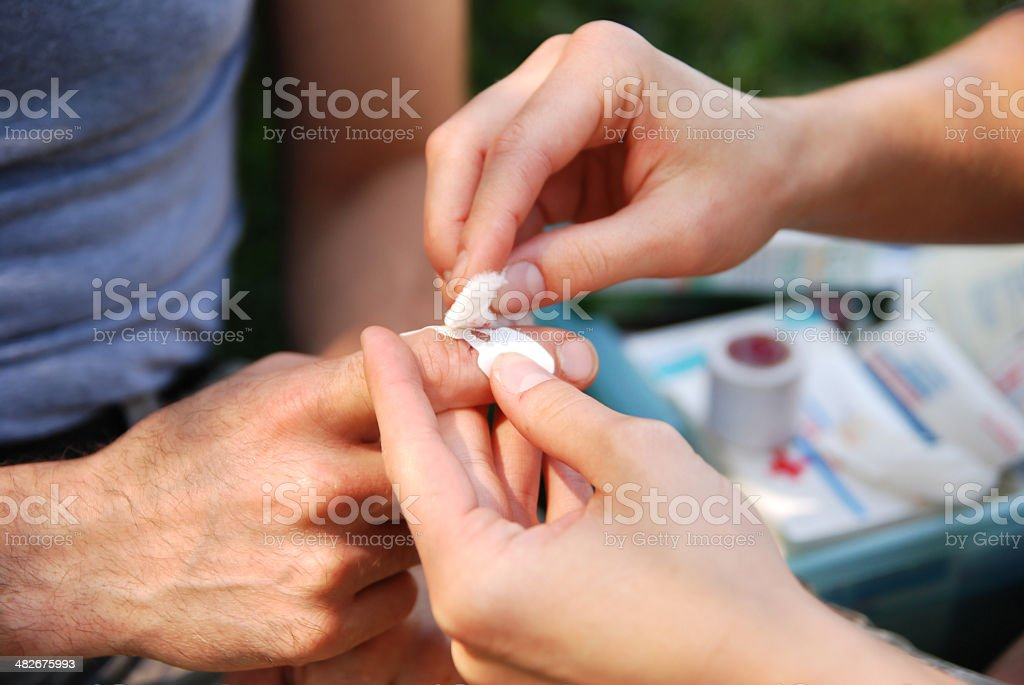 Bandaging a Cut Finger royalty-free stock photo