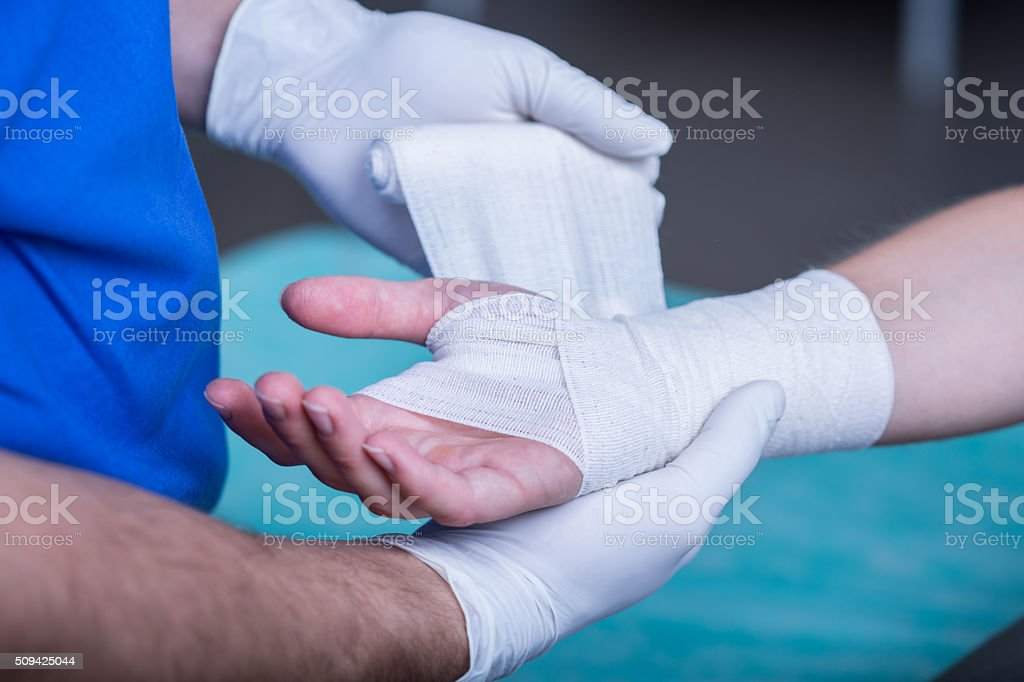 Bandaging a hand stock photo