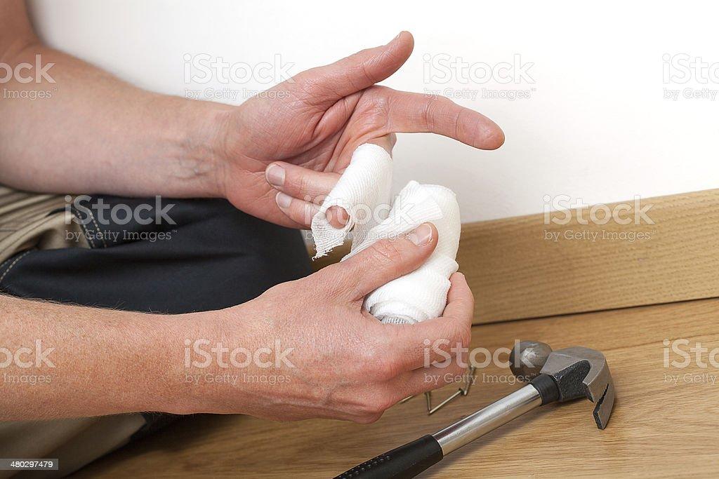Bandaging hurt finger royalty-free stock photo