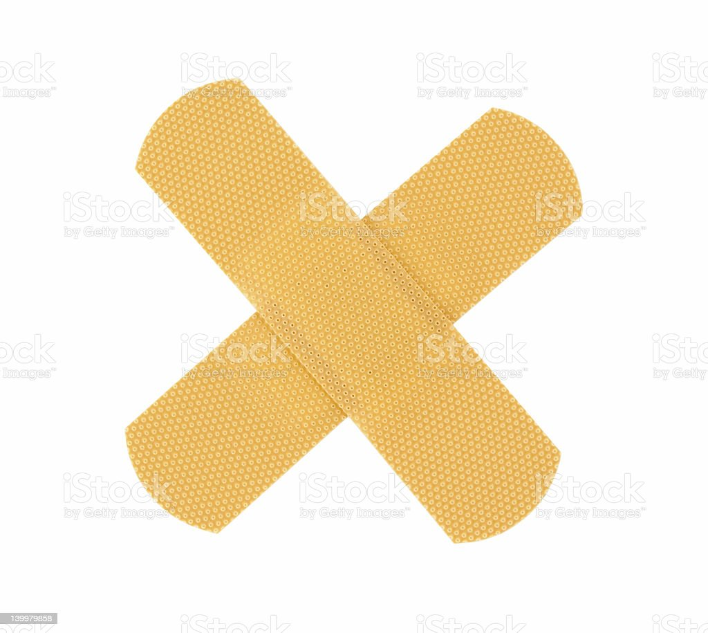 bandaid cross on pure white background royalty-free stock photo