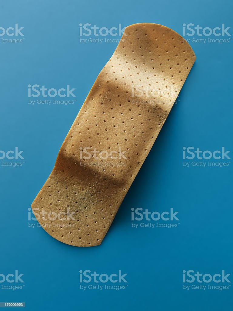 Band-Aid, isolated on blue stock photo