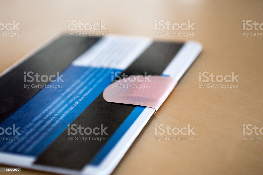 Bandaid/Plaster on a Credit/Debit Card royalty-free stock photo