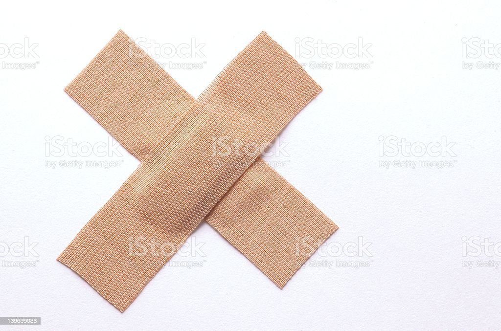 bandaids in cross formation stock photo