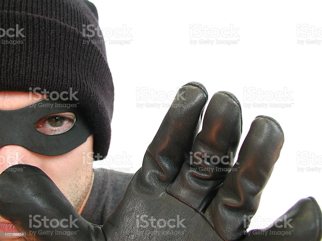 Bandit, Thief, or Burglar in Black Mask Reaching for You royalty-free stock photo