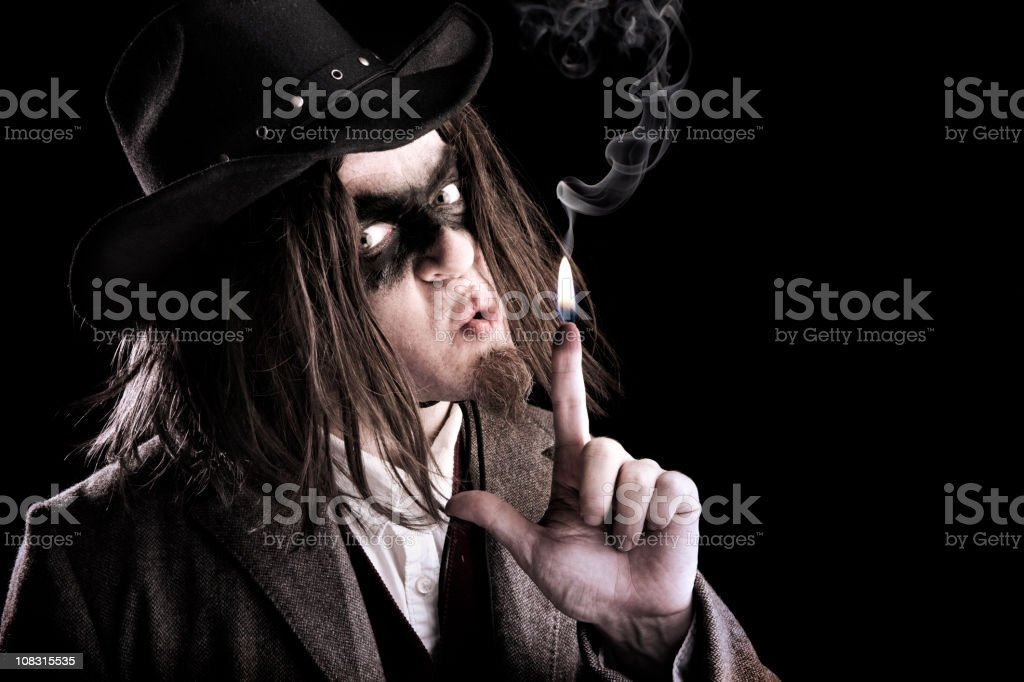 Bandit with Smoking HOT trigger finger stock photo