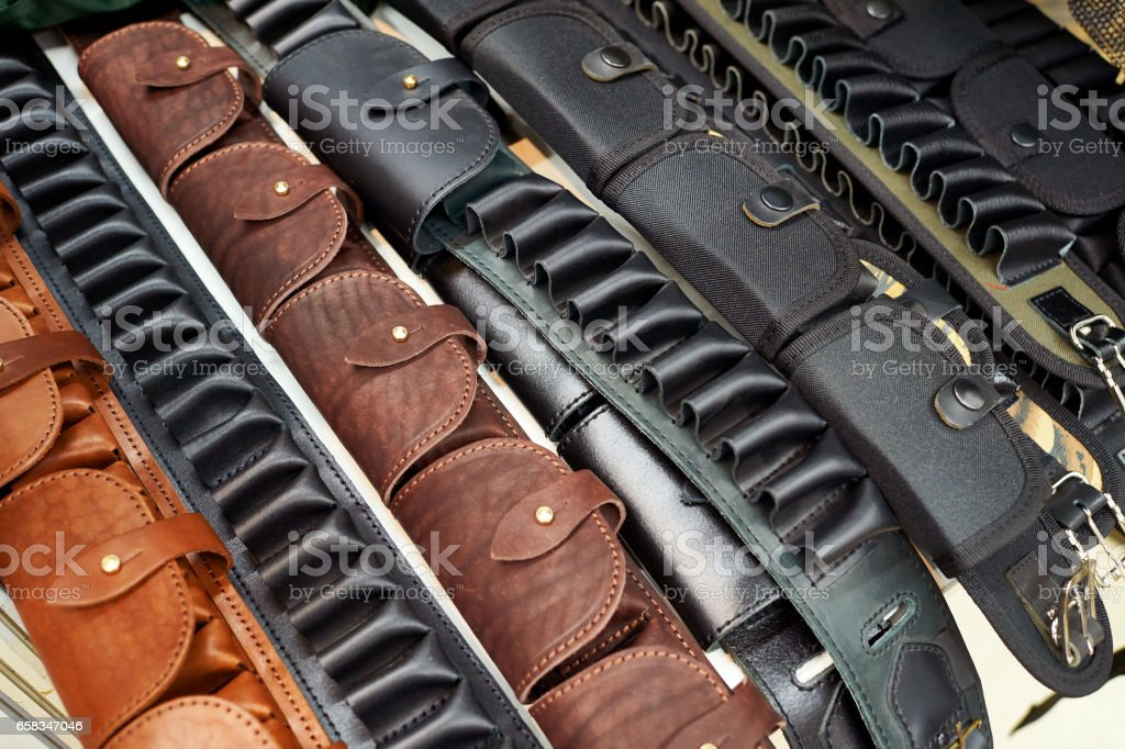 Bandolier for cartridges and ammo bags in arms store stock photo