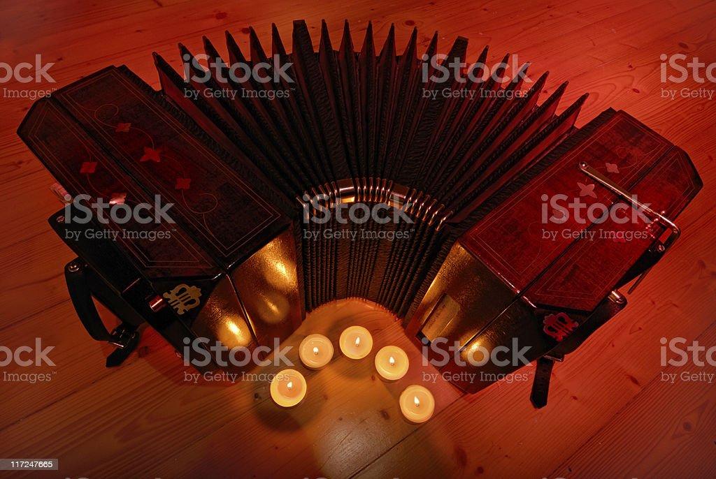bandoneon and tea candles stock photo