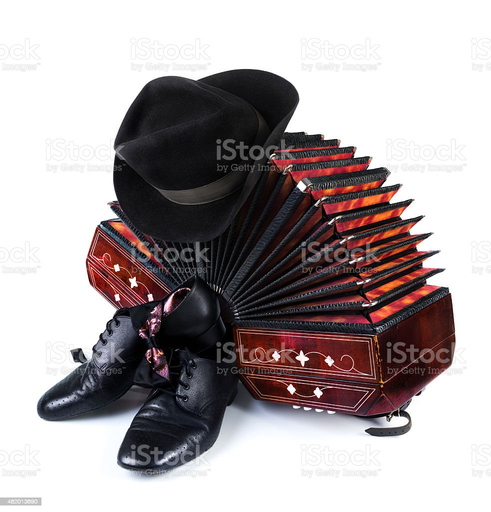 Bandoneon, black hat and tango shoes on white stock photo