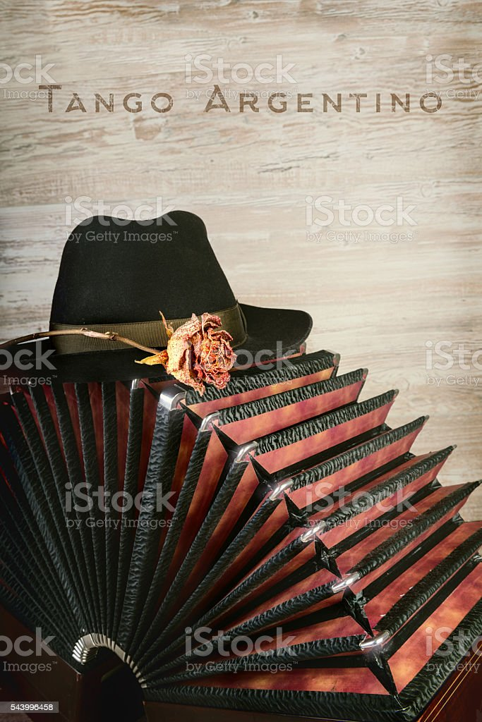 Bandoneon on wooden background, text 'Tango Argentino' stock photo
