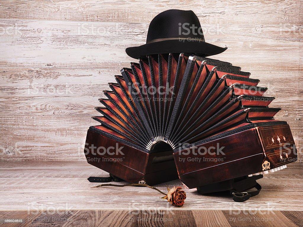 Bandoneon, tango instrument, and a hut stock photo
