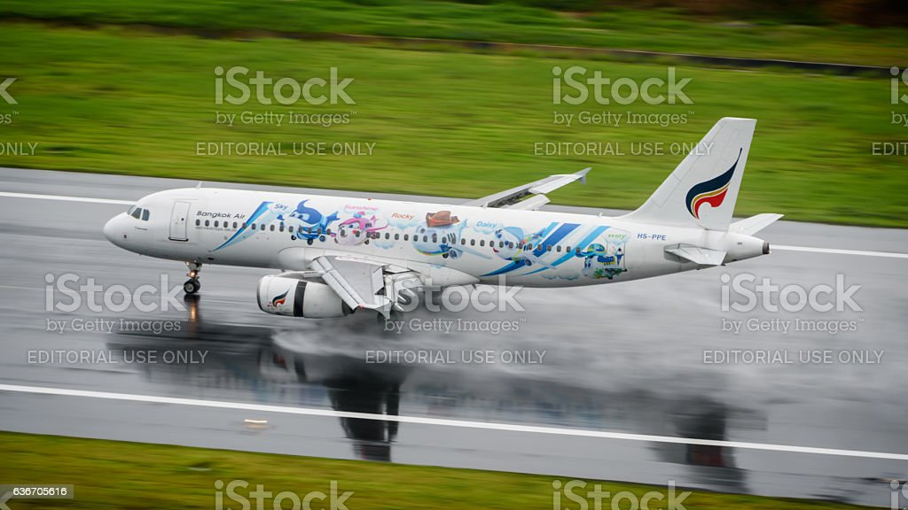 Bangkok airways take off from phuket on wet runway stock photo