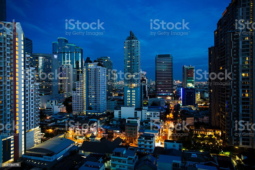 Bangkok city scape at night with skyscrapers and blue sky. stock photo