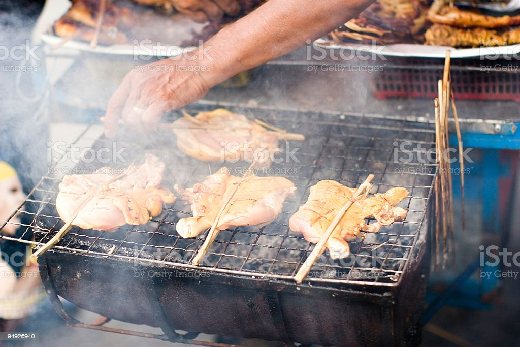 bangkok: grilled chicken legs sold by street vendor royalty-free stock photo