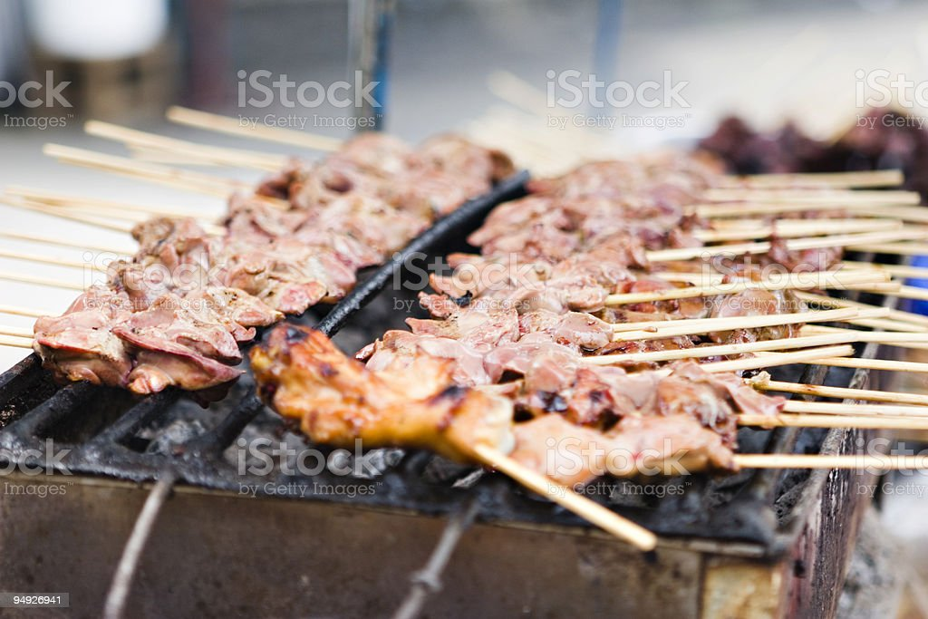 bangkok: grilled chicken sold by street food vendor royalty-free stock photo