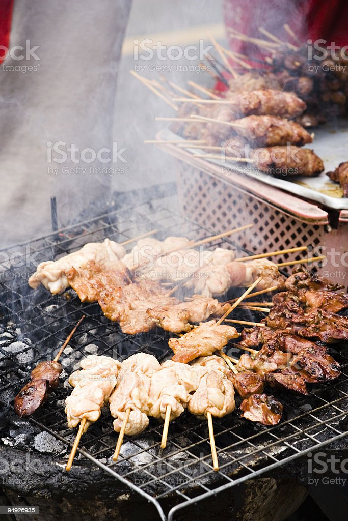 bangkok: grilled chicken wings sold by street vendor royalty-free stock photo