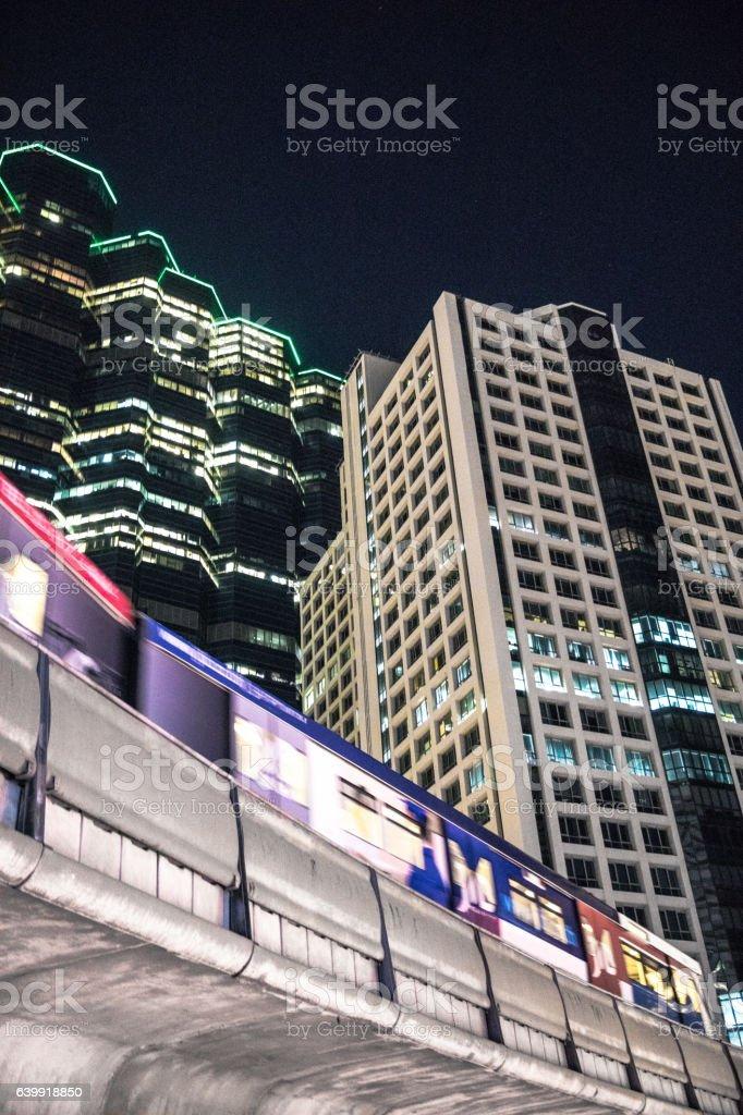 Bangkok Thailand, cityscape of modern building and train at night stock photo