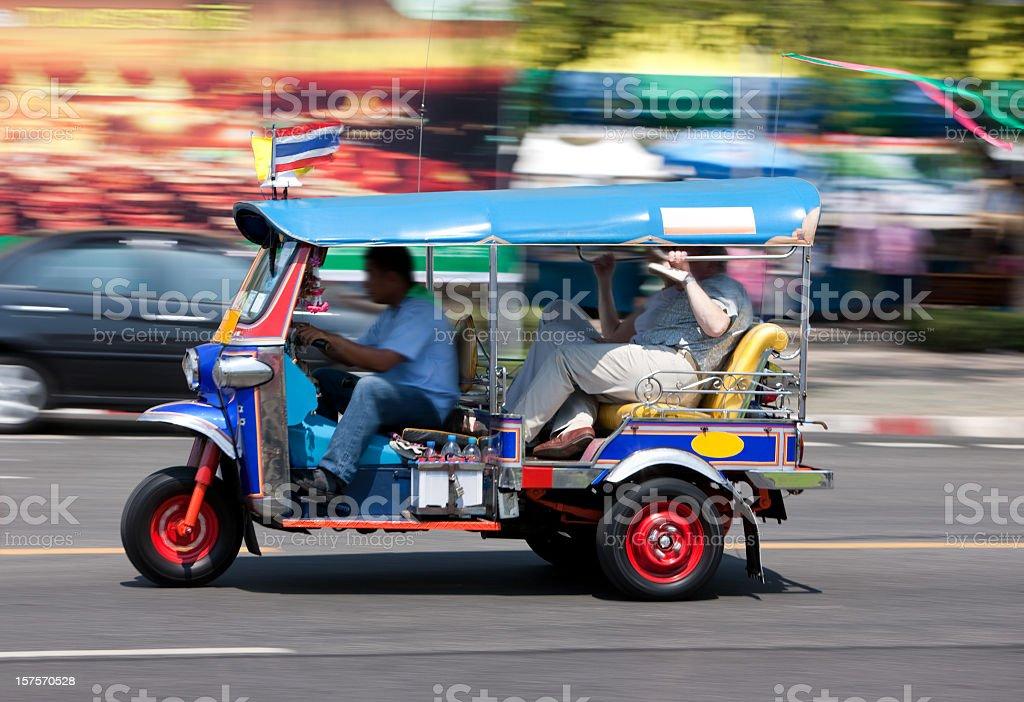 Bangkok Tuk-tuk with passengers. royalty-free stock photo
