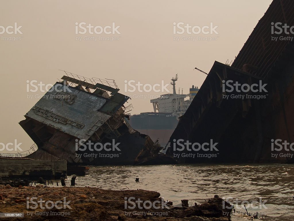 Bangladeshi workers risk lives in shipbreaking yards royalty-free stock photo