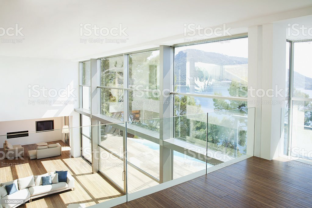 Banister overlooking modern living space royalty-free stock photo