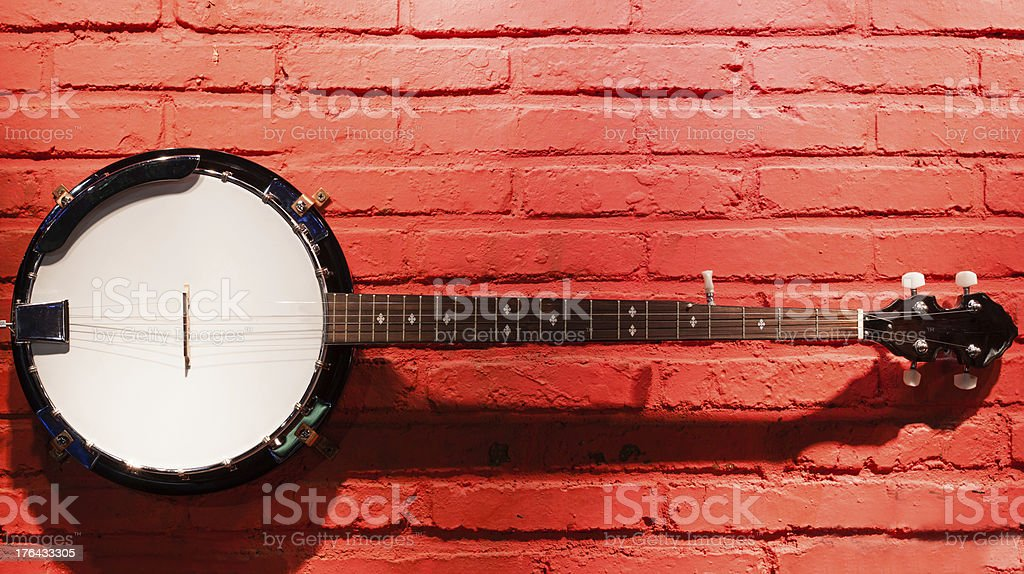 Banjo hanging on the wall stock photo