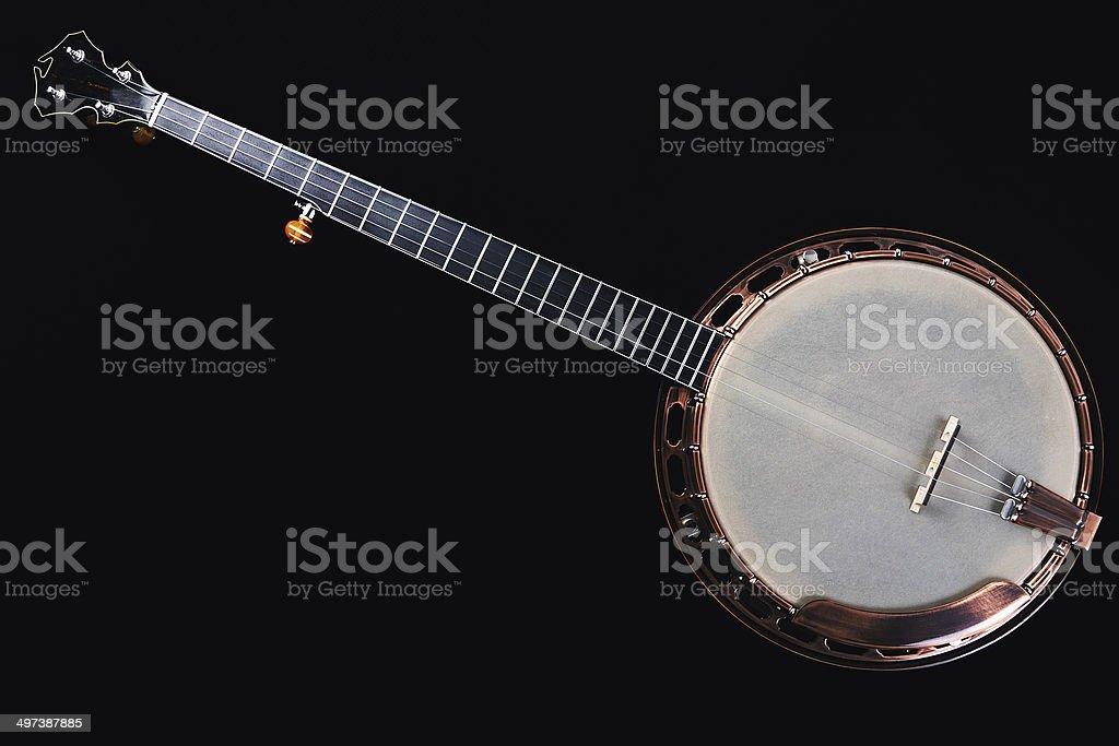 Banjo isolated on black background. stock photo