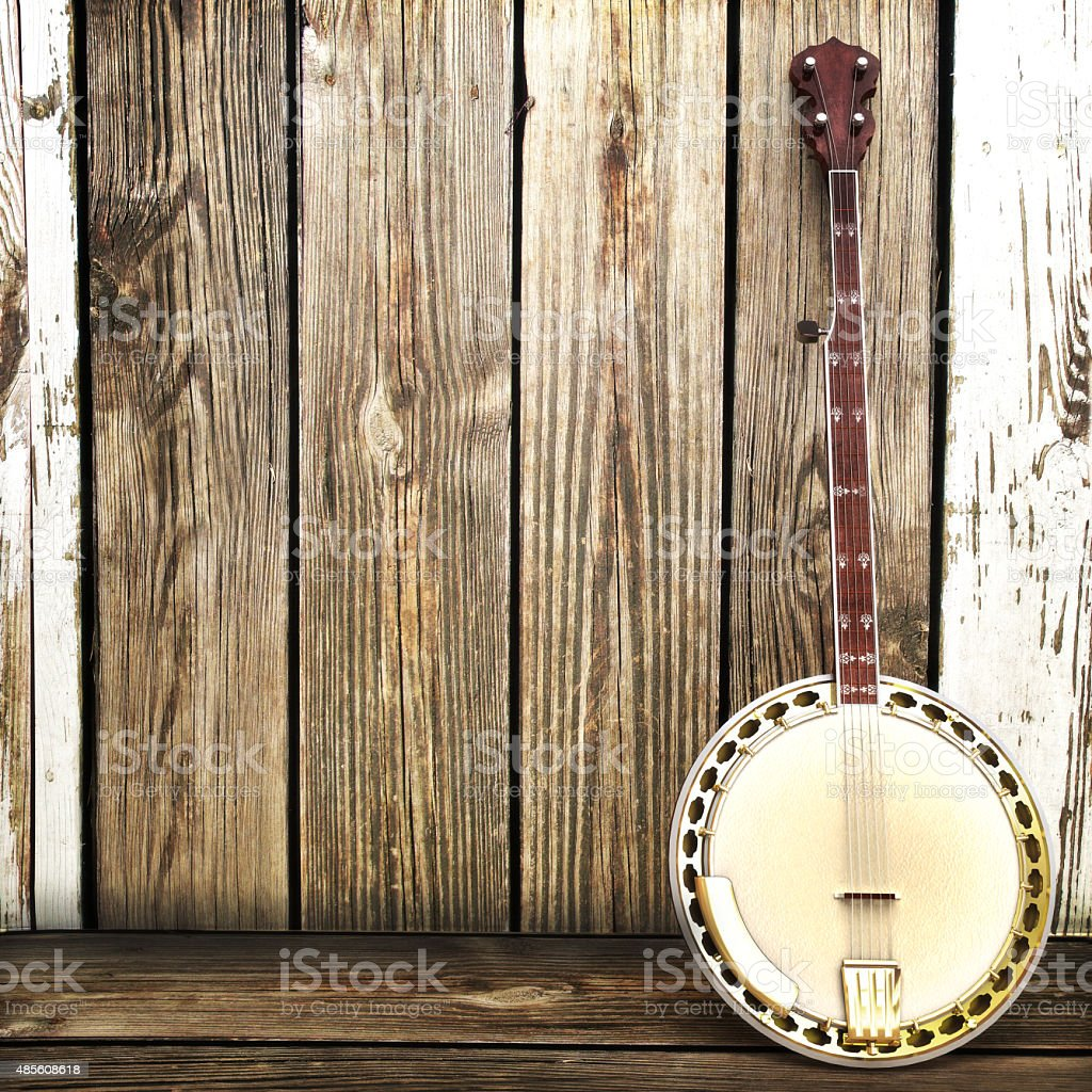 Banjo leaning on a wooden fence stock photo