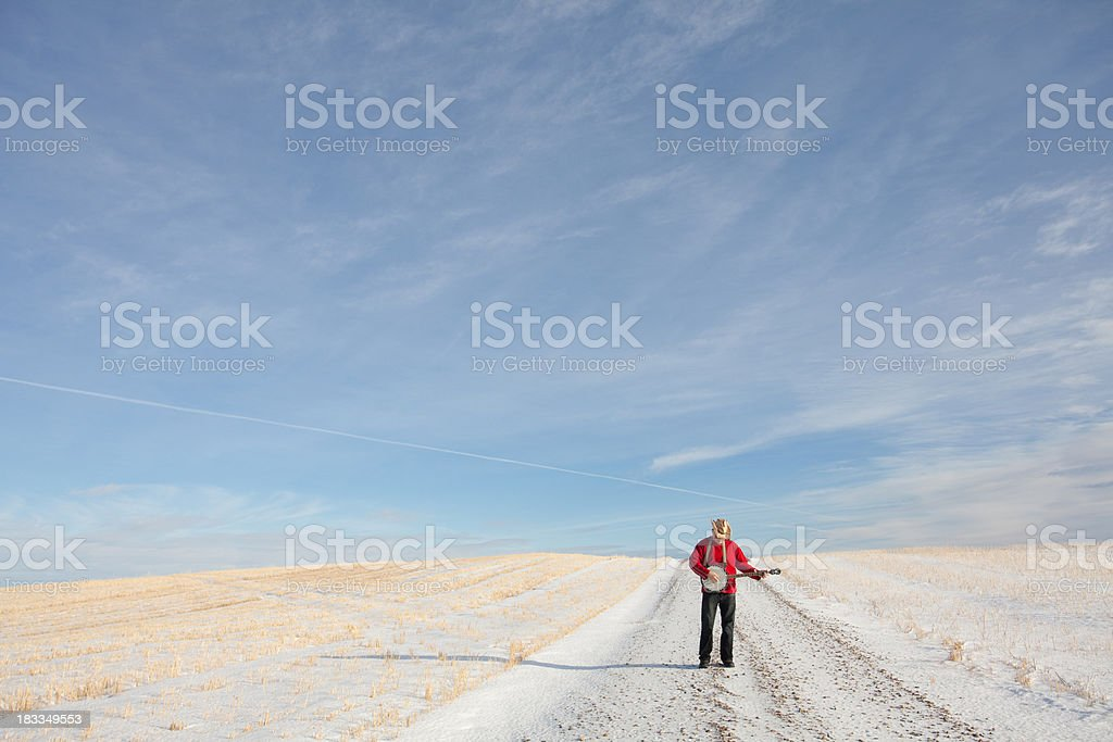 Banjo Player Outside on Country Road royalty-free stock photo