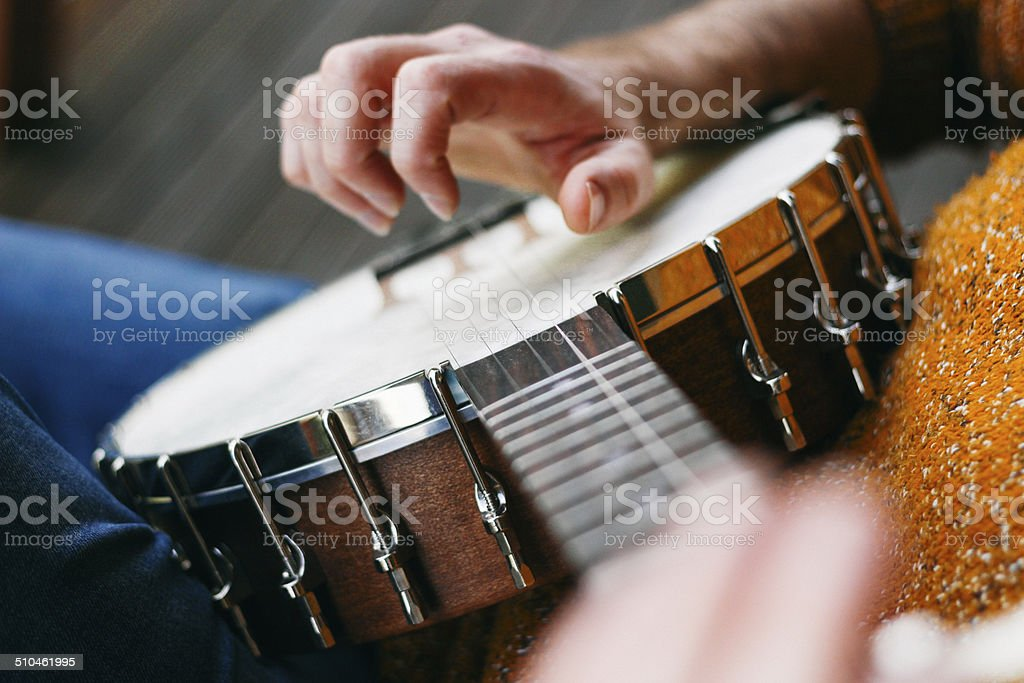 Banjo Player sitting in the sunshine stock photo